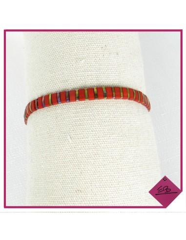 Bracelet élastiqué en acier doré et perles rouges et dorées,