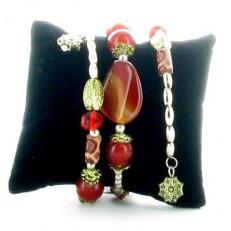 Bracelet ressort en pierres rouge et métal doré