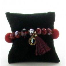 Bracelet de perles et boules tissus léopard et pompon rouge