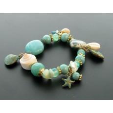 Bracelet à ressort et perles à dominance fushia et orange diverses pampilles