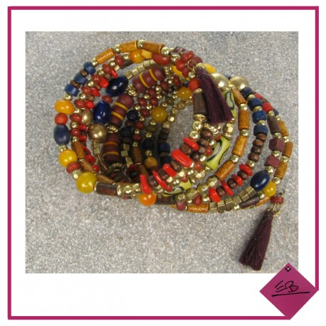 Bracelet multi-rang à ressort à dominance jaune en perles imitation bois, finition pompons